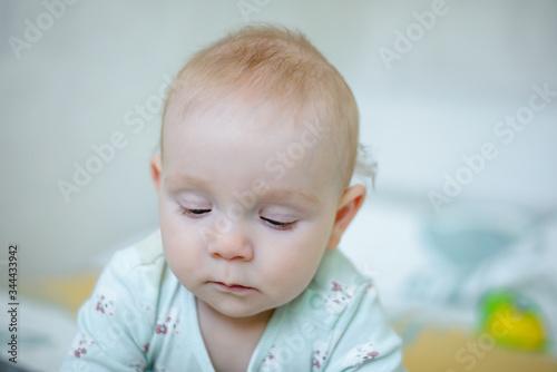 a sad little boy looks down. Portrait of an aggrieved child. Canvas Print