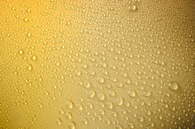 Close-up Of Water Drops On Yellow Metal