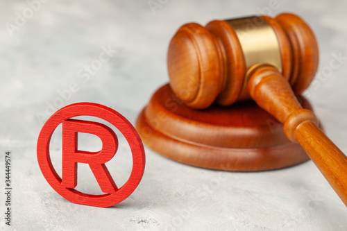Judge gavel and red trademark sign Canvas Print