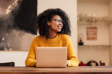Image Of Cheerful African American Woman In Eyeglasses Using Laptop