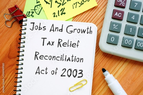 Fotografia Conceptual photo about Jobs And Growth Tax Relief Reconciliation Act of 2003 with handwritten phrase