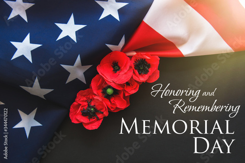 Photo American flag and a poppy flowers with Memorial Day Remember and Honor text back