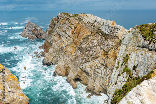 Rough sea in Cape Penas (Cabo de Peñas) in Asturias in the north of Spain Wallpaper Mural