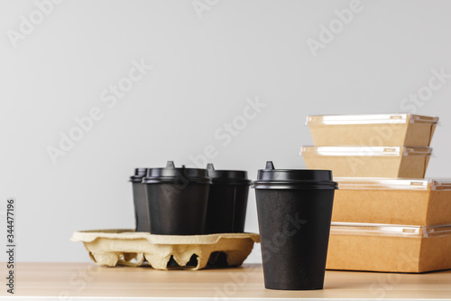 Fotografia Many various take-out food containers, pizza box, coffee cups and paper bags on light grey background