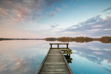 Wooden Pier On Big Lake With S...