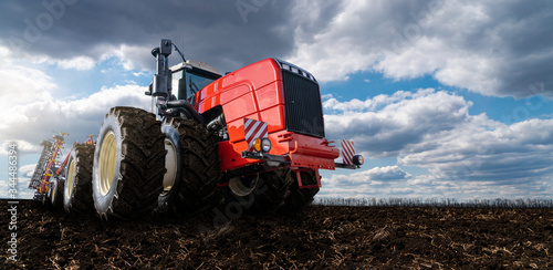 Aufkleber - Red tractor with plow on a agricultural field