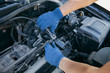 An auto mechanic repairing a car engine