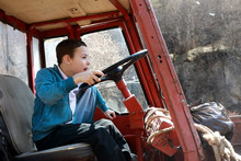 Child Driving Vintage Tractor