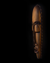 Wooden African Mask On A Black...
