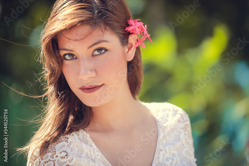 Fotografie, Tablou Portrait of beautiful smiling dark-haired young hispanic woman in summer green p