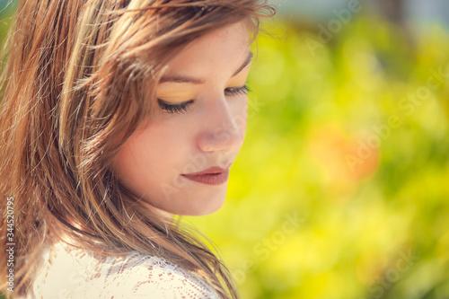 Fotografija Portrait of beautiful smiling dark-haired young hispanic woman in summer green p