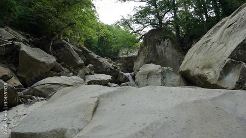Obraz na plátně Huge rockfall on a mountain river