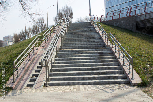Steps, rampant, a staircase with handrails, railings, descent and ascent for people with disabilities and prams, bicycles Wallpaper Mural