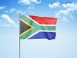 canvas print picture - South Africa flag waving sky background 3D illustration