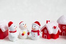 Three Smiling Toy Snowmen, Red...
