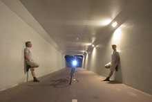 Double Portrait Of Man Standing In Tunnel