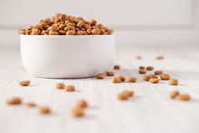 Dry Pet Food Is In A White Por...