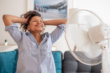 Black Woman Portrait Cooling Off At Home During Summer Heat