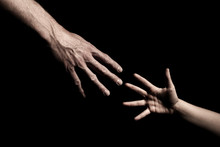 Hands Reaching Out To Each Oth...