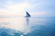Boats In Calm Sea Against Clou...