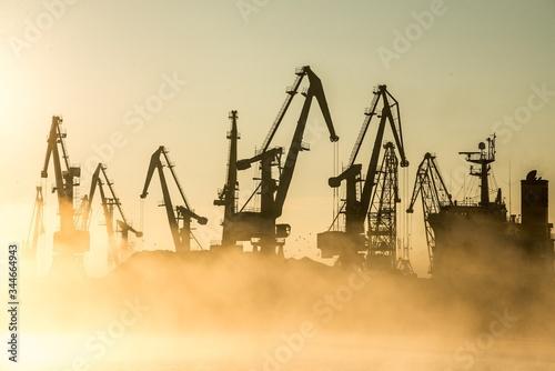 Obraz na plátně Low Angle View Of Cranes At Harbor