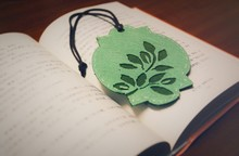 High Angle View Of Handmade Bookmark On Textbook