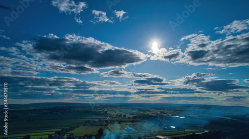 Blue sky and multiple clouds background showing a horizon