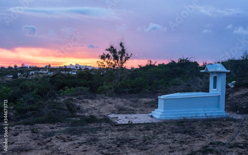 Photo cementery with sunset ambient near mui ne