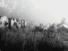 Abandoned Equipment On Field During Foggy Weather