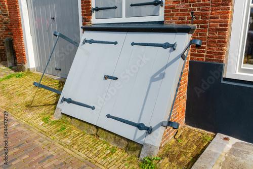 Fototapeta antique coal cellar door in Veere, Netherlands