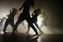 Silhouette Dancers Performing On Stage