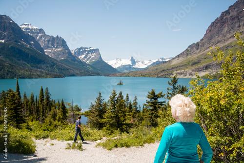 70 year old senior tourist woman looking at mountains and lake scenic view Tapéta, Fotótapéta