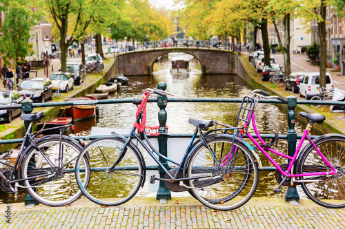 Fototapety, obrazy: bicycles leaning at a bridge railing in Amsterdam, Netherlands