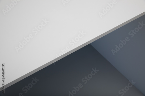 angular abstract background with shades of white and gray colors Canvas Print