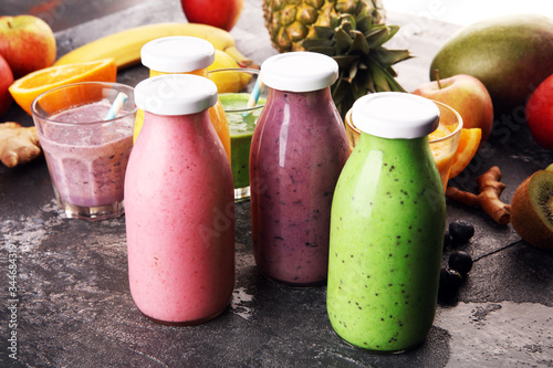 Assortment of fruit smoothies in glass bottles Canvas Print