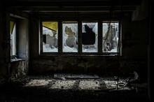 Damaged Windows Of Abandoned Building
