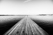 Wood Paneled Jetty At Calm Sea Against Clear Sky