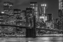 Brooklyn Bridge Over East River Against Illuminated Buildings