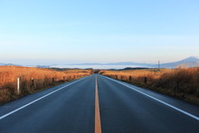 Empty Country Road Against Cle...