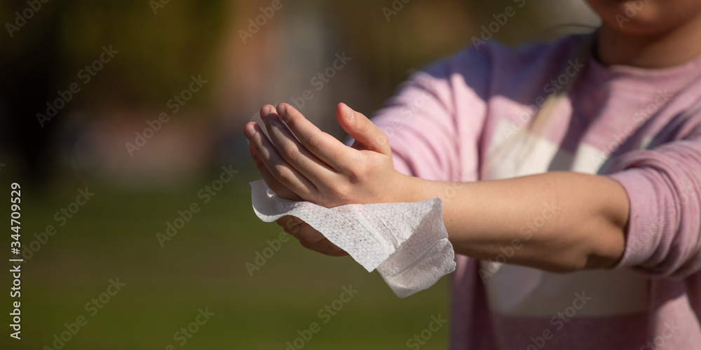 Fototapeta Prevention of influenza - Cleaning hands with wet wipes against disease infection like flu or influenza