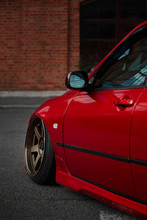Red Low Stance Car With Beautiful Wheels With Low Profile Rubber