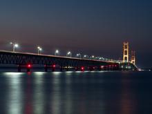 Illuminated Mackinac Bridge Over Strait At Night