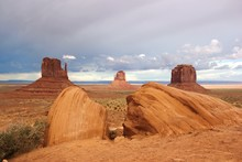 Scenic View Of Stack Rocks At Monument Valley Against Cloudy Sky