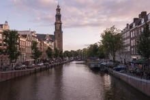 Canal Amidst City Against Sky During Dusk