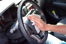 Man's Hand Cleaning Steering W...