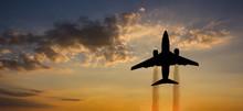 Airplane Taking Off At Sunset....