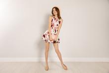 Young Woman Wearing Floral Pri...