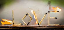 Close-up Of Love Text Made From Burning Matchsticks