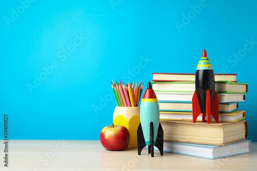 Fotografía Bright toy rockets and school supplies on wooden table