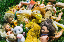Many Old Broken Dolls And Toys